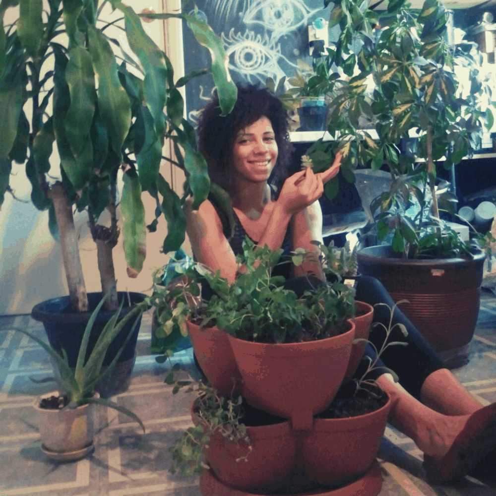 girl sitting with houseplants