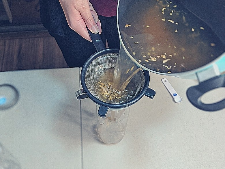 straining ginger beer