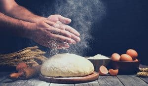 hands making bread