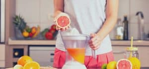 woman juicing a grapefruit