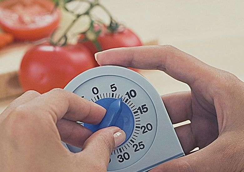 Person setting a kitchen timer