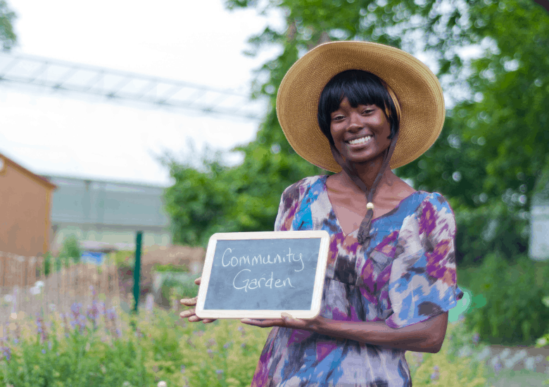 woman holding a gardening sign