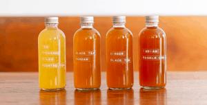 four bottles of kombucha