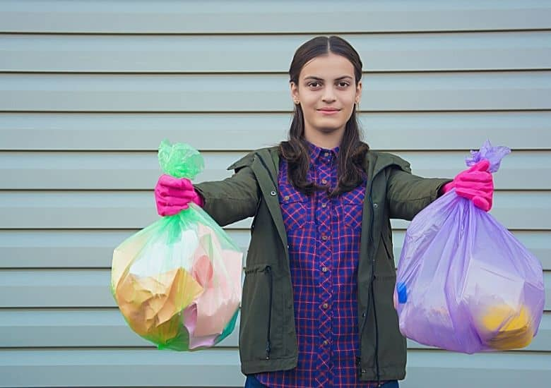 woman holding up trash